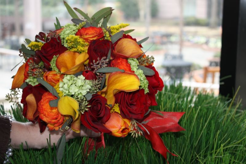 orange callas, circus roses, black magic roses, hypericum berry, seeded eucalyptus, green viburnum, red tulips, orange tulips