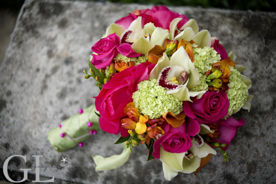 cymbidium Orchids, orange Calla Lily, green Viburnum, hot pink Peonies, Hot pink roses, Genevieve Leiper Photography