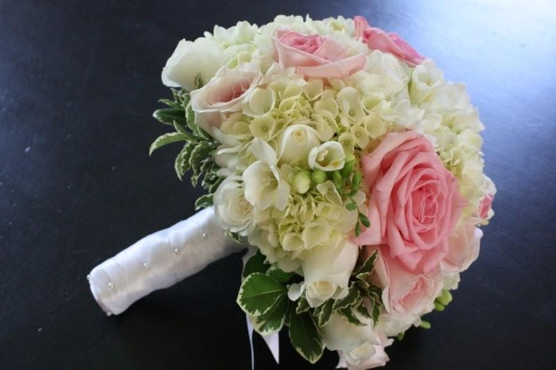 White Freesia Pink Roses Cream Hydrangea And Variegated Foliages