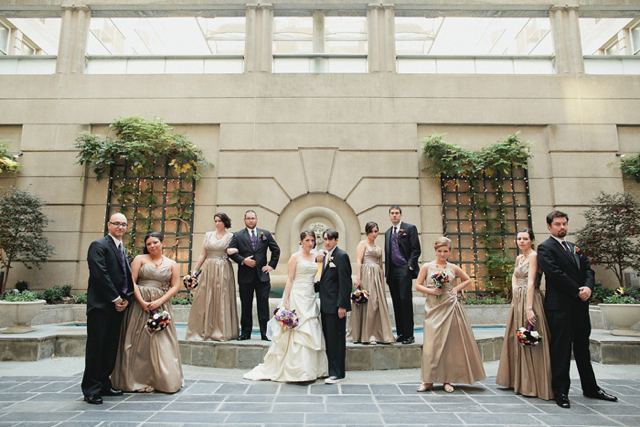 Their orange purple and white wedding flowers were designed by our studio