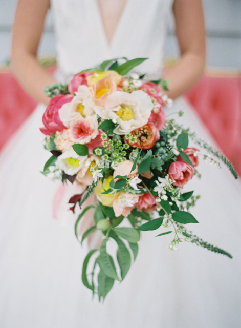 Cascading bridal bouquet by Holly Heider Chapple Flowers, Leesburg Virignia, with coral charm peonies, blush poppies, ranunculus, tulips and queen anne's lace