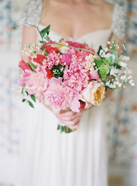 Bridal bouquet by designer Donna Sue Roberts, First Dance Floral - Southern Maryland, with coral godetia, pink peonies, peach garden roses, pink bouvardia, peach stock and sweet pea tendrils