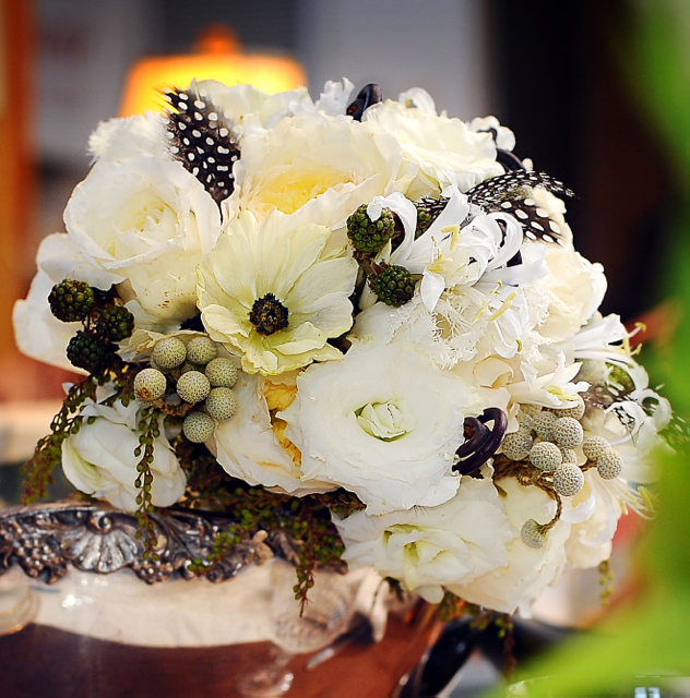 Wedding bouquet by designer Trish Van De Merkt - Chicago, Illinois, with Patience garden roses, white lisianthus, white nerine lilies, fern curls, brunia, white cosmos, black berries, peiris buds and guinea feathers