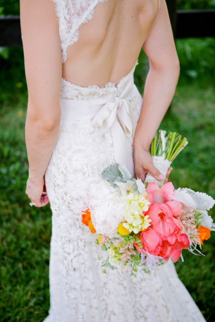 Bridal bouquet by designer Sue Prutting of White Magnolia Designs – Maryland, with coral charm peonies, astilbe, cream stock, craspedia and dusty miller