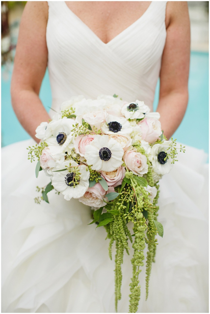 Cascading bridal bouquet by Eric Fredricks of Bee's Wedding and Event Floral Design - New Orleans, Louisiana, with black and white anemone, blush garden roses, seeded eucalyptus and hanging green amaranthus