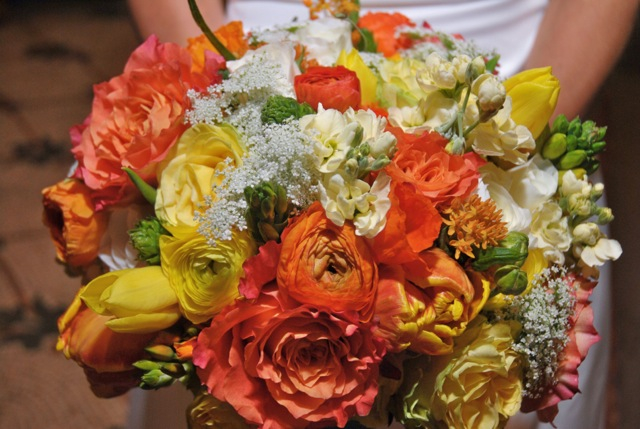 Bridal bouquet by designer Anna Stouffer of Urban Petals - Greenville, South Carolina, with Free Spirit roses, orange and yellow ranunculus, orange and yellow tulips, ascelpias, cream stock and queen anne's lace