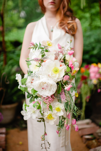 Cascading bridal bouquet by Designer Carmel Vandale of Mt. Lebanon Floral - Pittsburg, Pennsylvania, with white peonies, white poppies, white clematis, blush astilbe, blush sweet pea and blush veronica