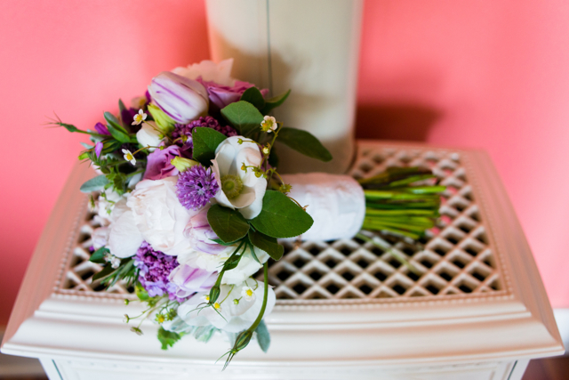 Wedding bouquet by Designer Faye Zierer Krause of Flora Organica Designs - California, with lilacs, hellebores, lisianthus, purple tulips, white peonies and strawberry blossoms
