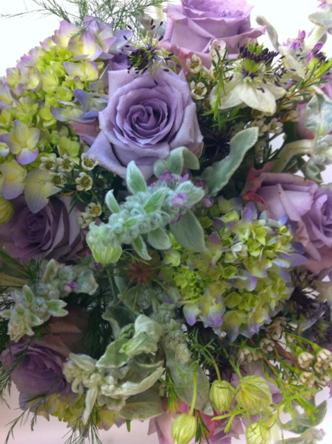 Wedding bouquet by Designer Ellen Seagraves - Bethesda, Maryland, with lavender hydrangea, lavender roses and waxflower