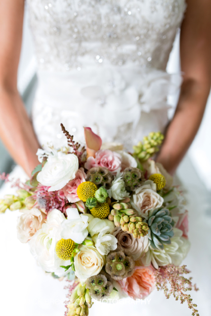 yBridal bouquet by Designer Eatherley Schultz 0f Floressence Flowers - Brevard, North Carolina, with Juliet garden roses, scabiiosa pods, craspedia, tuberose, succulents, blushing bride protea, white freesia, white ranunculus, blush astilbe, blush dahlias and ivory roses