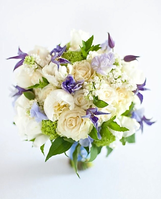 Wedding bouquet by designer Ellen Snyder of Ellen Snyder Design – Vermont, with purple clematis, lavender sweet pea, white peonies, white lilac, white roses, viburnum and mint
