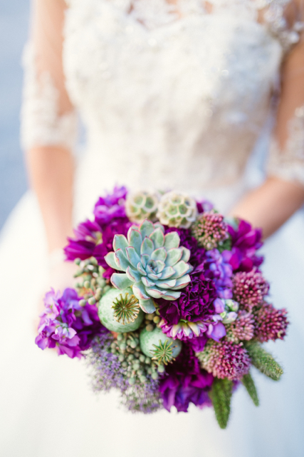 bridal bouquet by designer Sharon Duke of Isn't She Lovely Florals – Florida, with succulents, poppy pods, purple carnations, bullet allium, stock and scabiosa pods