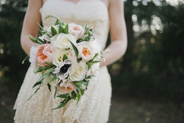 Bridal bouquet by Designer Meredith Young of Au Courant - Jackson, Mississippi, with Juliet garden frose white roses, anemone and jasmine vine