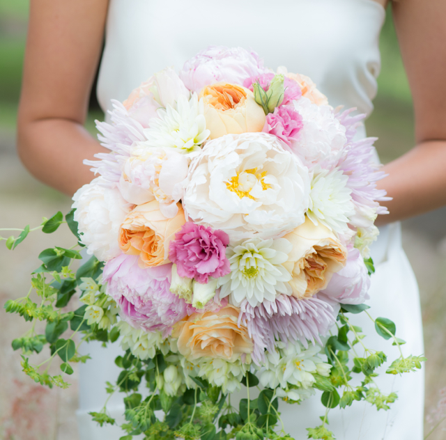 Bridal bouquet by designer Lisa Almeida of Blossoms of Hawaii - Wailuku, Maui, Hawaii, with white and pink peonies, pink lisianthus, white dahlias, Juliet garden roses and bupleurum