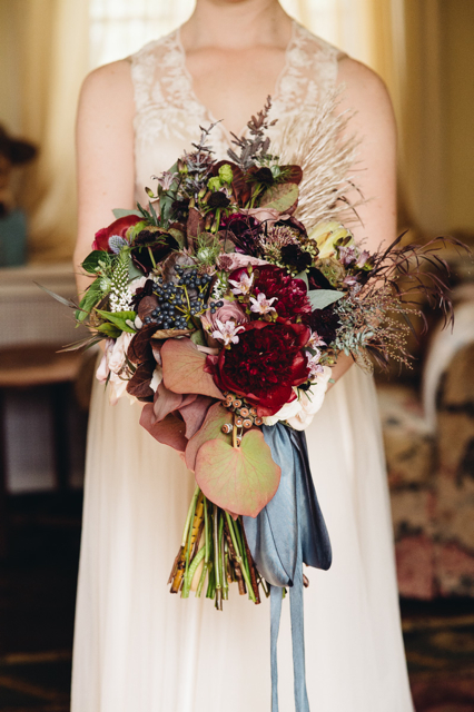 dark toned Bridal bouquet by designer Cynthia Manchester of Oleander Florals and Events - New Jersey, with burgundy peonies, acacia foliage, agonis, viburnum berries, white veronica and amnesia roses