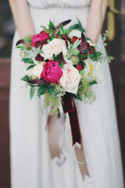 Cascading bridal bouquet by designer Olga Dudarenko of the Flower Bazar - Moscow, Russia, with pink peonies, blush garden roses and cascading ribbon