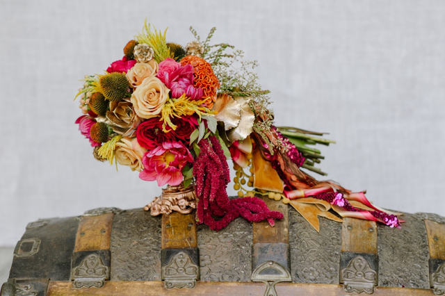 Cascading bridal bouquet by designer Dawn Kelly of Soiree Floral – Nantucket, Massachusetts, with Echinacea, coral dahlias, orange cockscomb, nude roses, yellow feather celosia, dark pink garden roses, pieris buds, gold scabiosa pods, gold succulents, red hanging amaranthus, seeded eucalyptus and cascading vintage ribbons