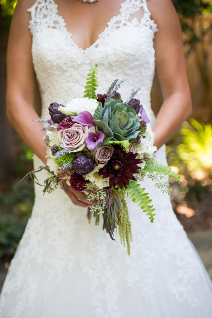 Bridal bouquet by designer Kristi Landphere of The Posh Posey - Folsom, CA, with purple artichokes, burgundy dahlias, kale, fuschia mini callas, amnesia roses, bullet allium, seeded eucalyptus, agonis, ivory lisianthus, white scabiosa, lavender, fern and hanging amaranthus