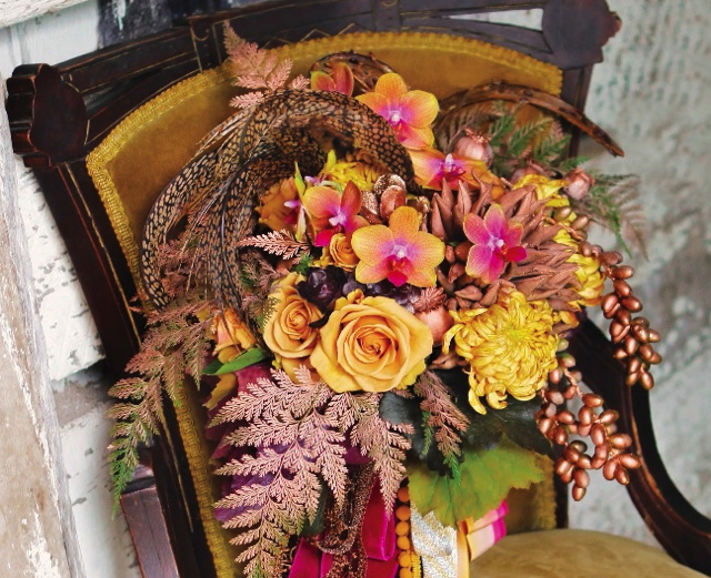 Bridal bouquet by designer Stacy Ercan from Stacy K Florals - Rochester, NY, with gold roses, gold and pink phalaenopsis orchids, football mums, copper fern, copper dates, pheasant feathers and cascading ribbon