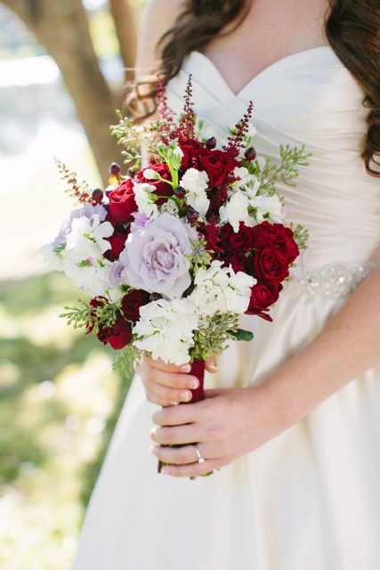 Bridal bouquet by Designer Lauren Walloch of Garden Gate Florals - Central Florida, with lavender roses, red roses, white stock, astilbe and seeded eucalyptus