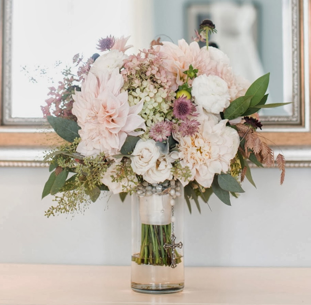 Bridal bouquet by designer Corinne Sebesta Sisti of Sebesta Design LLC – Narbeth, Pennsylvania, with hydrangea, café au lait dahlias, white ranunculus, astrantia, northern sea oats and seeded eucalyptus