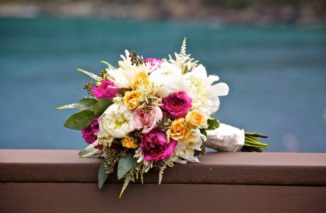 Wedding bouquet by stylist Mary Bartolucci of Island Style Weddings- St. John United States Virgin Islands, with white peonies, white astilbe, fuchsia garden roses, yellow spray roses and seeded eucalyptus
