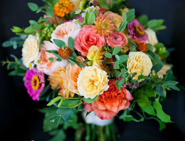 Bridal bouquet by designer Heather Potter of Cottage Flowers - Malvern, Pennsylvania, with Free Spirit roses, Juliet garden roses, coral roses, orange dahlias, fuchsia zinnias and orange gomphrena