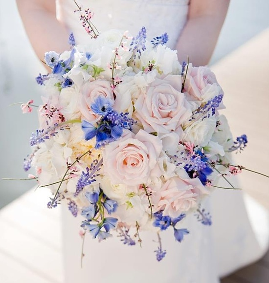 Bridal bouquet by designer Lisa Sommer of Petals and Promises - Silver Spring, Maryland, with delphinium, muscari, genestra, blush roses, white sweet pea and ranunculus