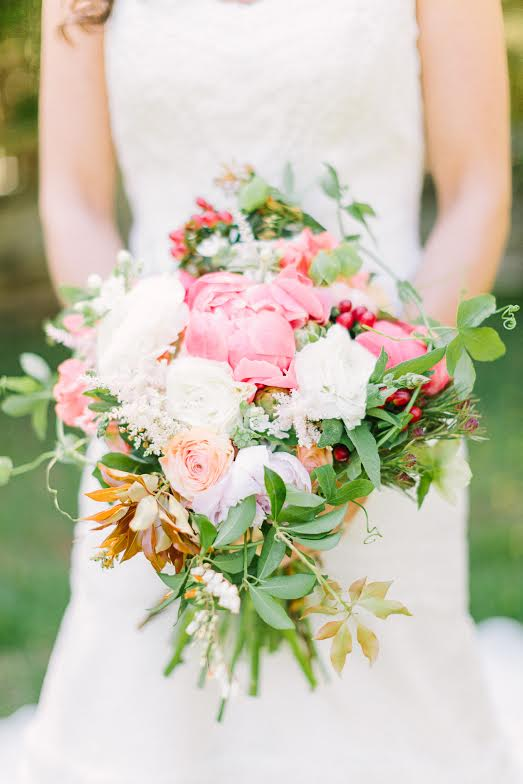 Bridal bouquet by designer Sherry Donnelly from Gertie Mae's Floral Studio - Atlanta, Georgia, with Coral Charm peonies, peach ranunculus, hypericum berries and passion vine