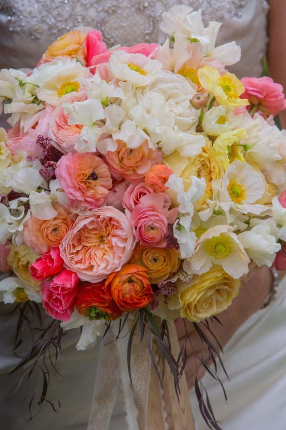 Bridal bouquet by designer Victoria Clausen of Victoria Clausen Floral Events – Reisterstown, Maryland, with white sweet peas, white and yellow poppies, yellow garden roses, peach ranunculus, Juliet garden roses, coral godetia, sarracenia and agonis
