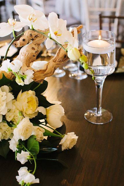 centerpiece with candlelight, white flower arrangement