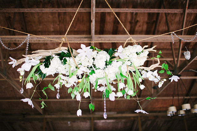white hanging flower arrangement, hollyish