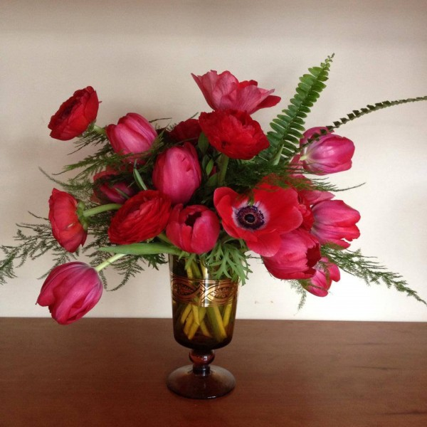 red tulips anemones fern in footed vase primrose floral event design chapel designers