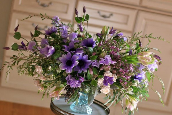 purple anemones on glass compote white magnolia designs and chapel designers