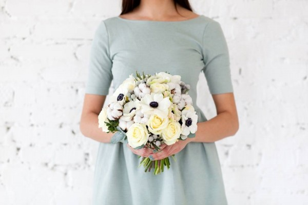 bouquet of roses and anemones flowerbazar chapel designer blue dress