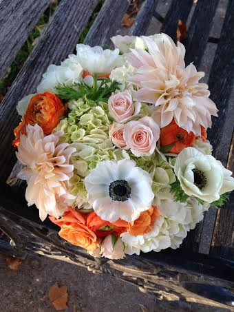 roses dahlias black and white anemones in bouquet by haute blossoms chapel designer