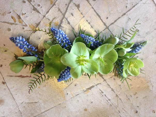 blue and green hairpiece of muscari and helebores sebesta design chapel designer
