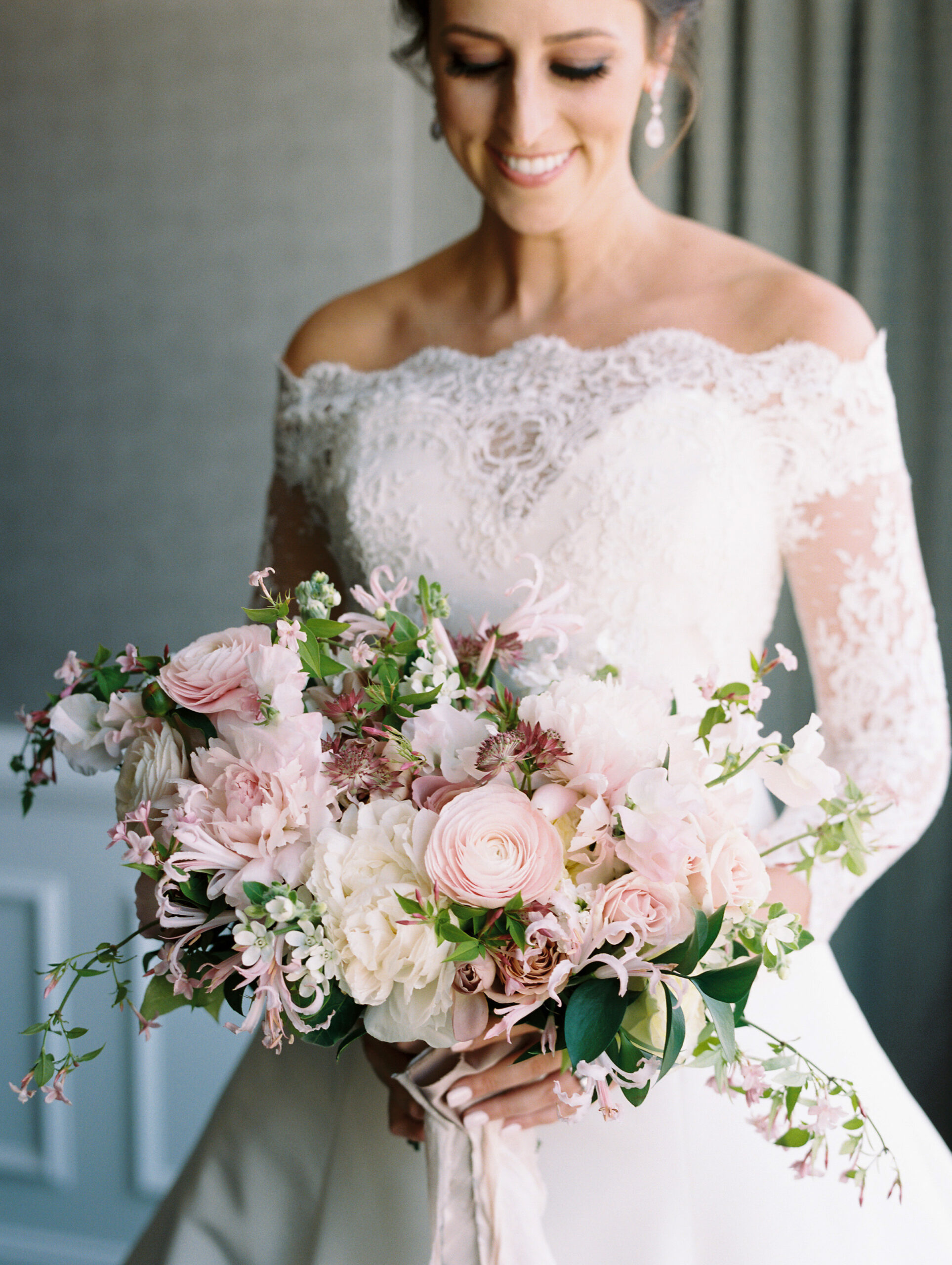 blush ranunculus, blush nerine, blush peonies, white and blush bridal bouquet